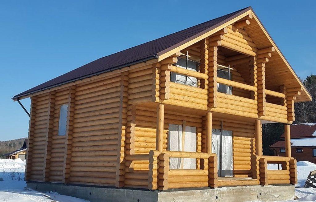 Зимний дом из оцилиндрованного бревна